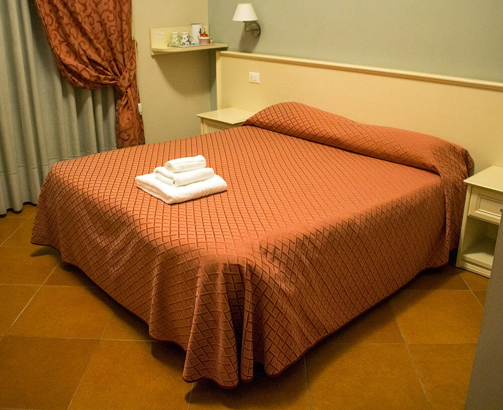 The huge bed at Ottaviano Guest House